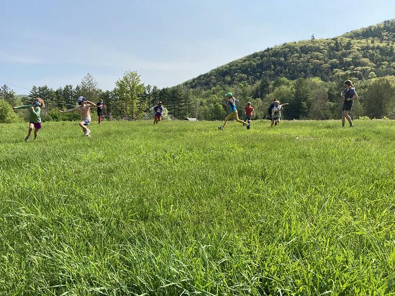 students playing in the field