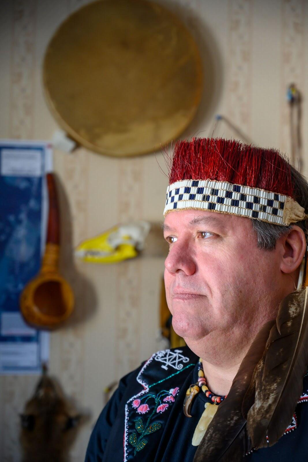 Chief Don Stevens of the Nulhegan Band of the Coosuk Abenaki Nation photographed in his home wearing traditional headdress and beaded necklace. Photo: Caleb Kenna Photography