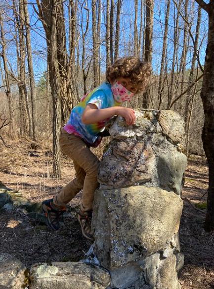Climbing the rock wall.