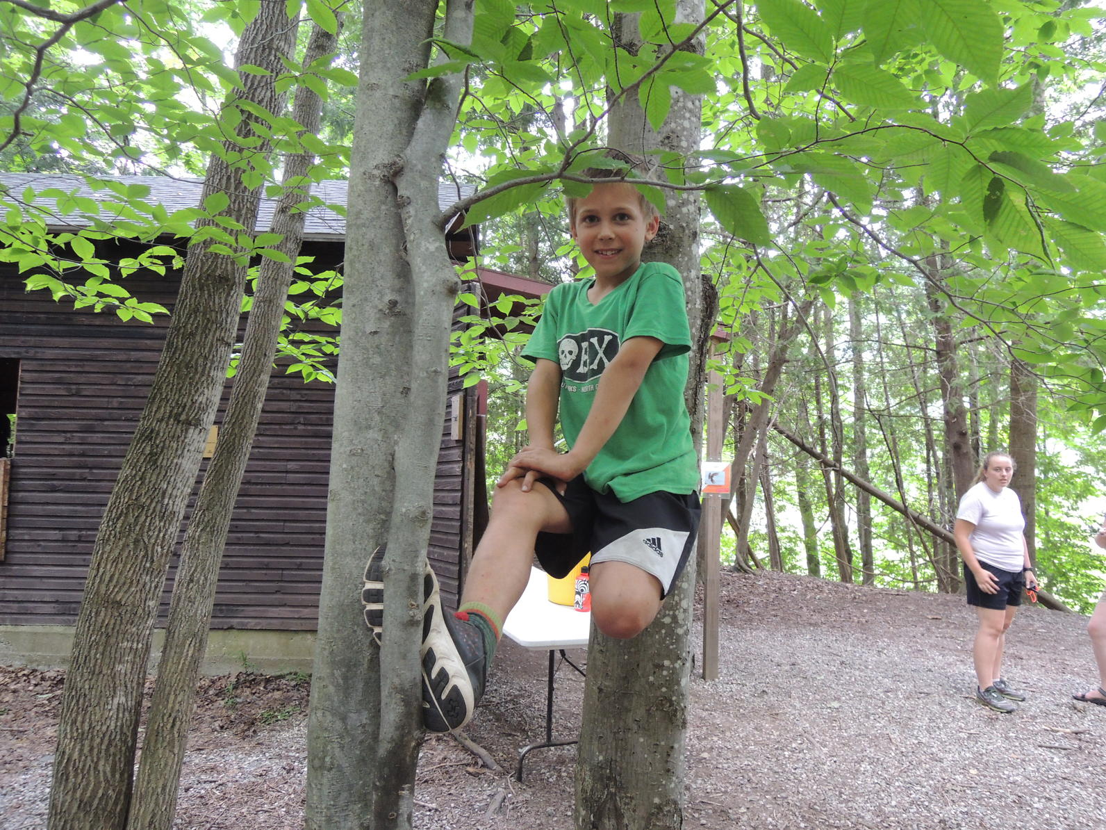 Camper climbing at camp