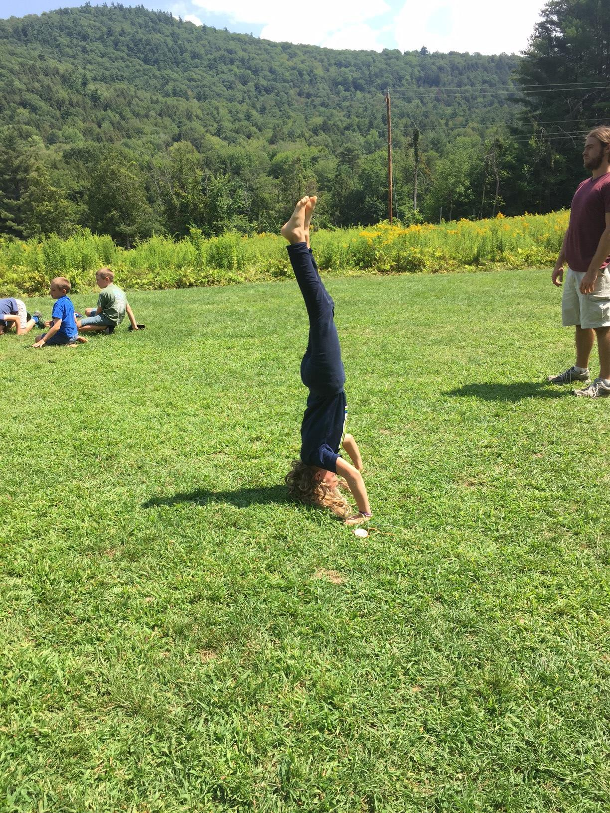 headstand camp
