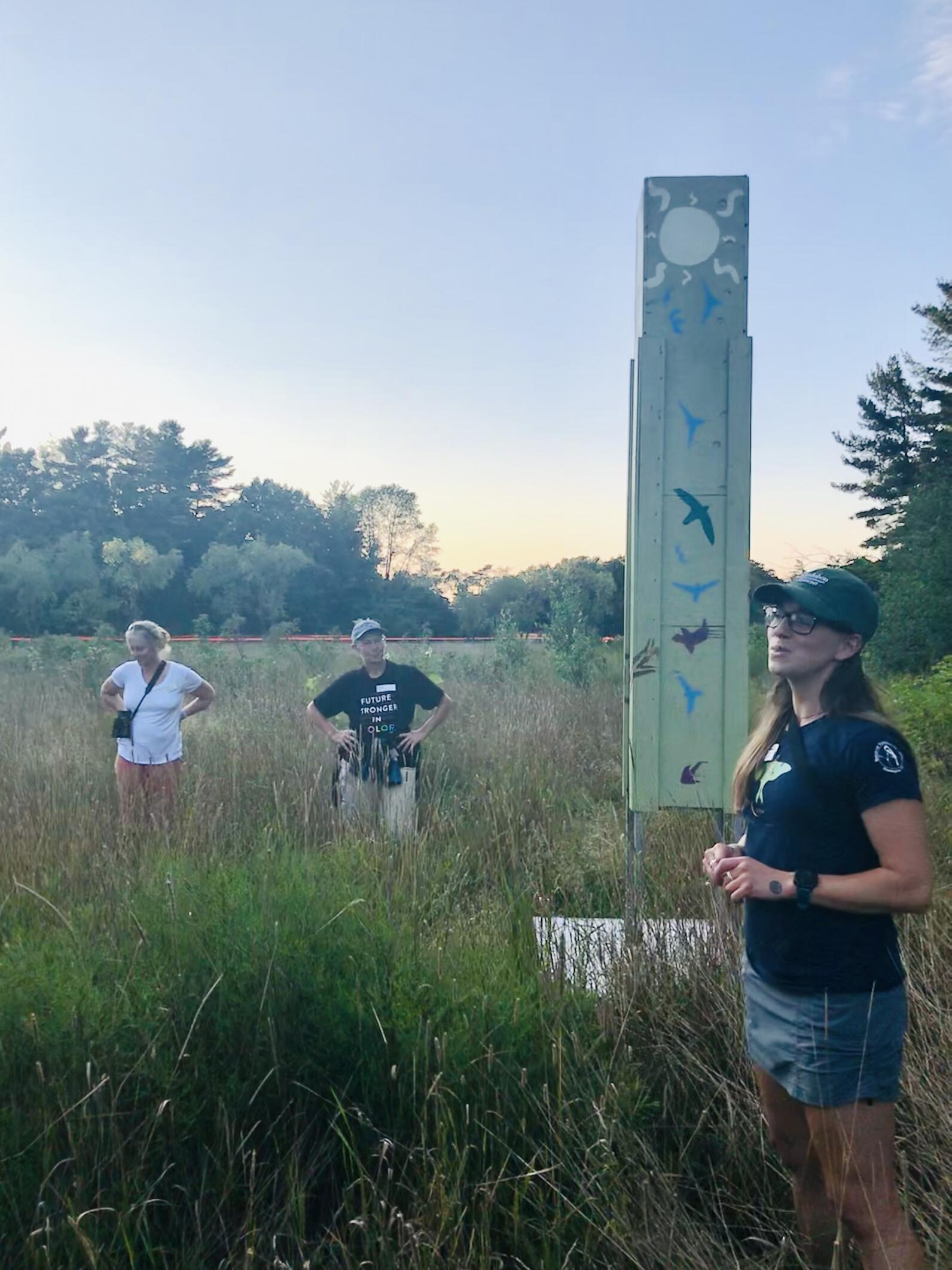 Rae Bronenkant, an educator with Audubon Vermont stands in front of the Oakledge Park Chimney Swift tower to explain how it functions in the wetland.